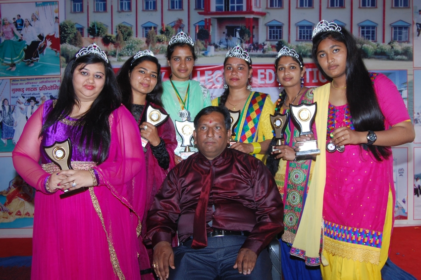 Dr. Sanjay Sharma, Principal of college with the award winning students of college