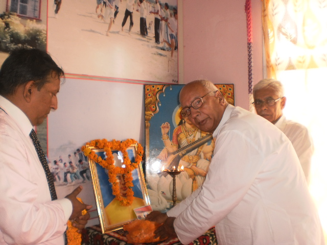 Prof. S.S. Verma lighting a lamp on the occasion of Teacher's Day